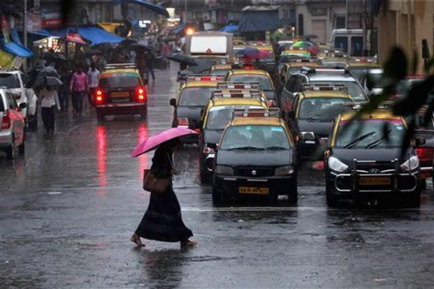 Despite the heavy rains local train services in Mumbai largely remained unaffected. Photo: PTI