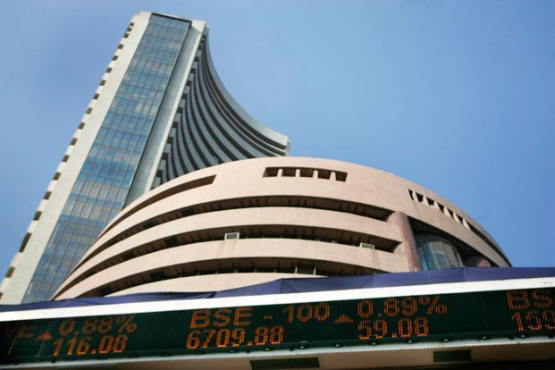 Markets close at record high, Nifty falls short of 10000-mark