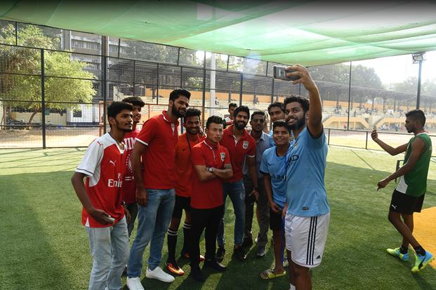 Jackichand Singh (centre) with teammates at a Mumbai City FC football event. Photo: Mumbai City FC website