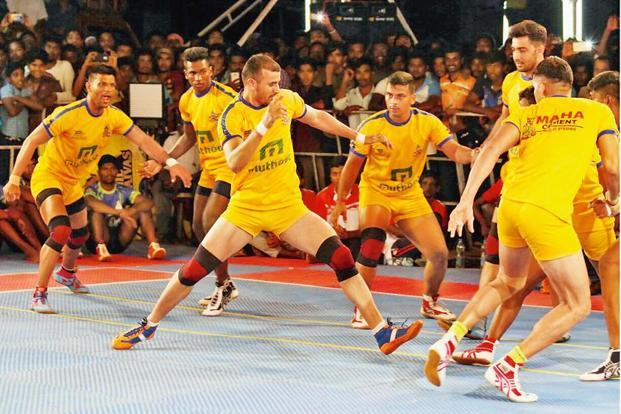 A file photo of Ajay Thakur (centre) in action during a Pro Kabaddi League match. Thakur says PKL has given kabaddi players and the sport an identity.