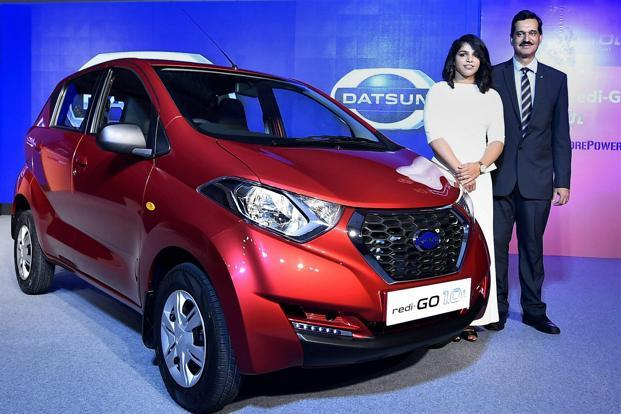 Datsun redi-Go brand ambassador Olympic medallist Sakshi Malik with managing director of Nissan India, Arun Malhotra at the launch of the car on Wednesday. Photo: PTI
