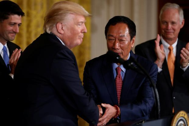 Foxconn chairman Terry Gou (second from right) shakes hands with US President Donald Trump during a White House event where the Taiwanese electronics manufacturer announced plans to build a $10 billion dollar LCD display panel screen plant in Wisconsin in Washington on Wednesday. Photo: Reuters