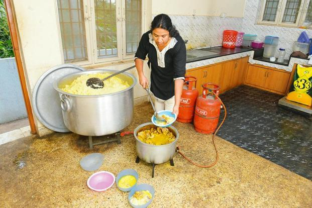 Bismi cooks around 75kg of chicken and rice with mutton fat to feed street dogs every day. Photo: Hemant Mishra/Mint