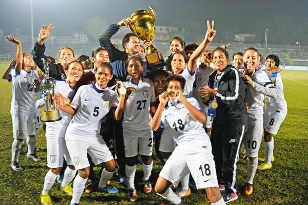 Indian women's football team celebrates its victory in the final of Saff women's football championship in Siliguri on 4 January. Photo: AFP