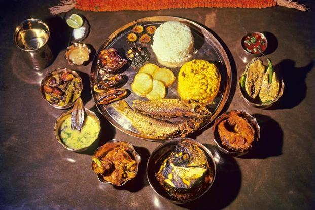 A ceremonial Bengali 'thali' with several kinds of fish. Photo: Goutam Chatterjee/Dinodia Photo.
