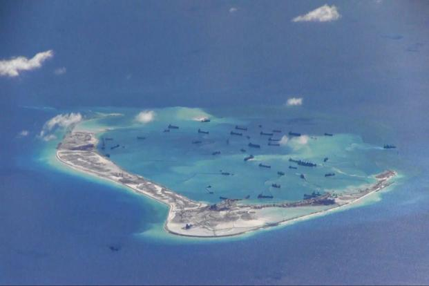 Chinese dredging vessels are purportedly seen in the waters around Mischief Reef in the disputed Spratly Islands in the South China Sea. File Photo: Reuters