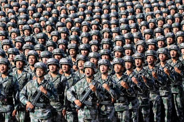 Soldiers of China's People's Liberation Army (PLA) get ready for the military parade to commemorate the 90th anniversary of the foundation of the army at Zhurihe military training base in Inner Mongolia Autonomous Region, China, Sunday. Photo: Reuters