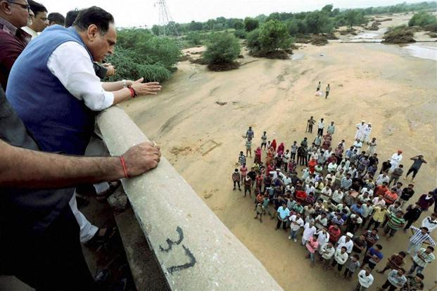 Gujarat chief minister Vijay Rupani (left) takes stock of the flood situation in hard-hit Banaskantha district of Gujarat on Sunday. PTI