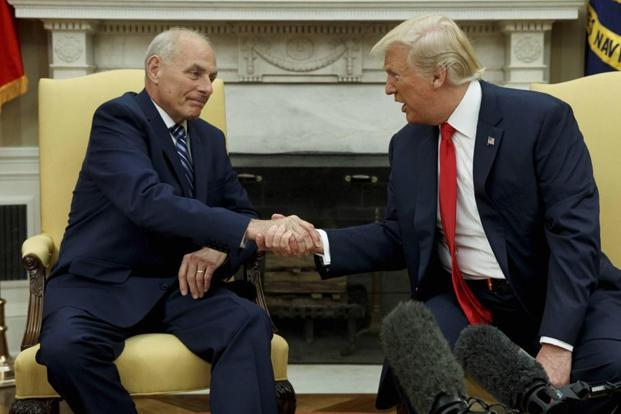President Donald Trump talks with new White House chief of staff John Kelly after he was privately sworn in during a ceremony in the Oval Office on 31 July in Washington. Photo: AP