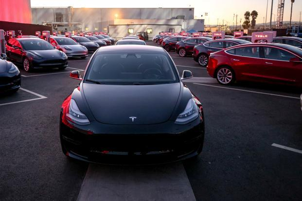 Launched on Friday, Tesla's Model 3 is built to be a daily driver with plenty of cupholders, door pockets, and console storage. Photo: Reuters