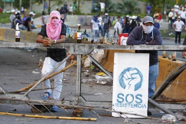 Demonstrators man a barricade after clashes broke out while the Constituent Assembly election was being carried out in Caracas, Venezuela, on 30 July. Photo: Christian Veron/Reuters