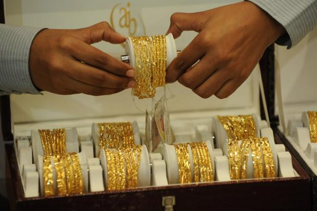 Globally, gold fell by 0.02% to $1,268.80 an ounce in New York in Monday's trade. Photo: AFP