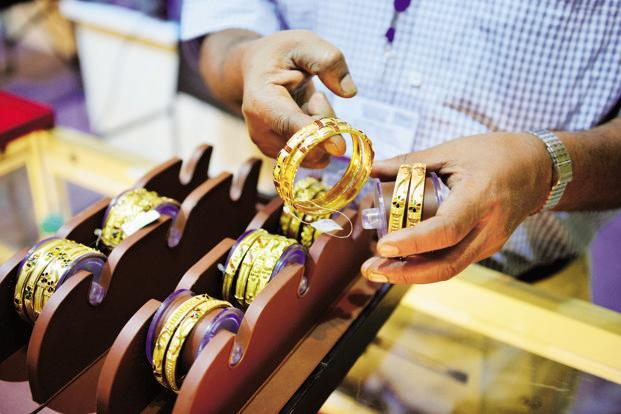 Pure gold prices moved down by Rs45 to conclude at Rs 28,645 per 10 grams as compared to Rs28,690 previously. Photo: Mint