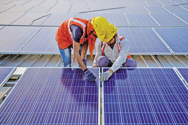 Dollar-denominated tariffs in power purchase agreements free solar power developers from foreign exchange risks. Photo: AFP