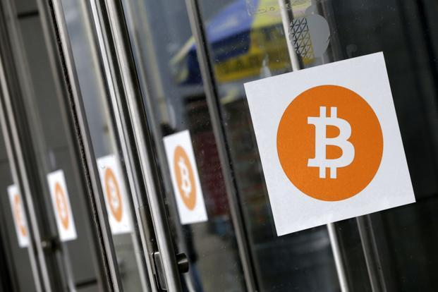 The debate over how to scale bitcoin came to a head on Tuesday as some cryptocurrency miners started using software called Bitcoin Cash and splitting a new blockchain off the old one. Photo: AP