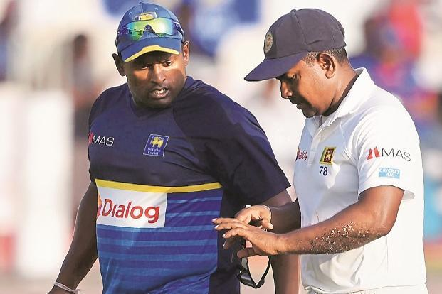 Rangana Herath (right) got injured in the first Test. Photo: AFP