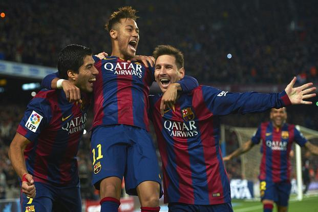 (From left to right) Luis Suarez, Neymar and Lionel Messi of Barcelona. Transfer fees are increasing at a scarily fast pace, as Neymar's PSG deal shows. Photo: AP