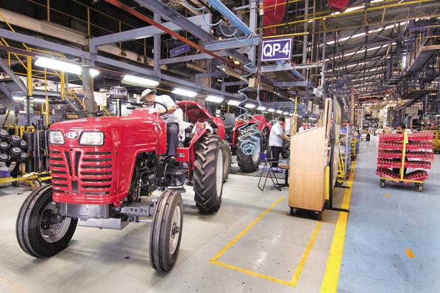 The jump in Mahindra and Mahindra's tractor sales in the June quarter indicates that rural demand is looking up on the back of plentiful monsoon rain. Photo: Abhijit Bhatlekar/Mint