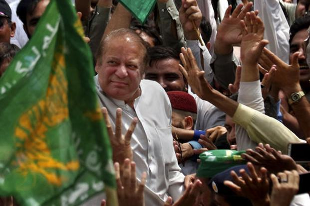 Nawaz Sharif waves to supporters, who gathered on a highway to welcome him at Bhara Kahu area on the outskirts of Islamabad on Saturday. Photo: AP