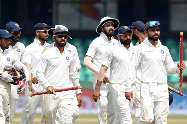 Indian cricketers leave the ground led by captain Virat Kohli after victory in the second Test match between Sri Lanka and India at the Sinhalese Sports Club Ground in Colombo on 6 August. Photo: Lakruwan Wanniarachchi/AFP