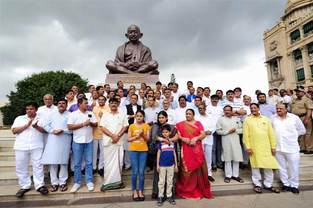 Gujarat Congress MLAs in front of the statue of Mahatma Gandhi during their visit to the Karnataka assembly in Bengaluru on Saturday. Photo: PTI