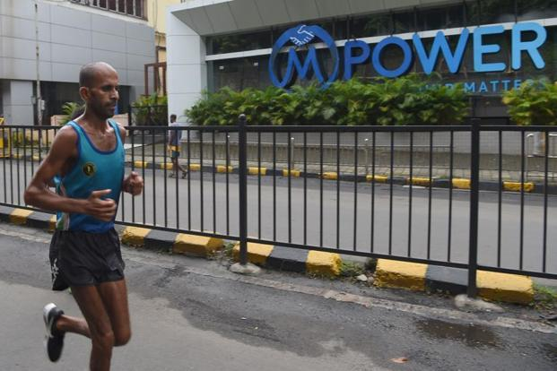 Ultra marathon runner Samir Singh was just 36km short of completing 10,000km that he wanted to cover in the 100-day challenge as pain and exhaustion beat him. Photos: AFP