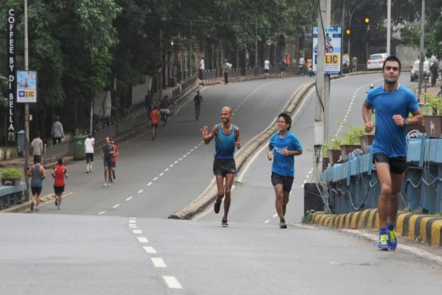 Singh waves to other runners in Mumbai. At the end of his attempt on Sunday, the running coach, who also suffered stomach problems and viral fever, weighed just 40kg.