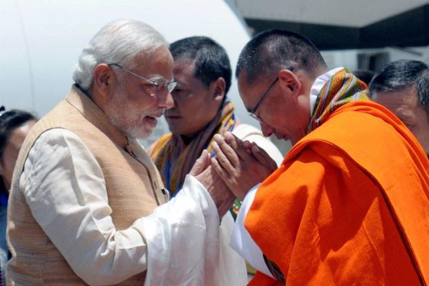 Prime Minister Narendra Modi being received by his Bhutanese counterpart Tshering Tobgay on his arrival at the Paro International Airport in Bhutan in 2014. Photo: PTI
