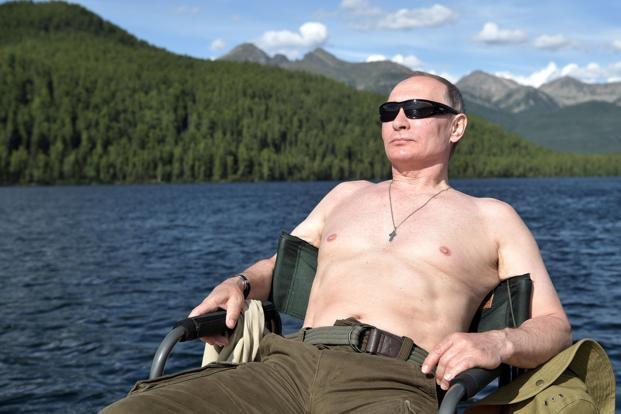 The Kremlin's slant is that a shirtless Vladimir Putin in dark glasses, floating in the middle of a remote Siberian lake, is not a guy who cares much about US sanctions. Photo: Reuters