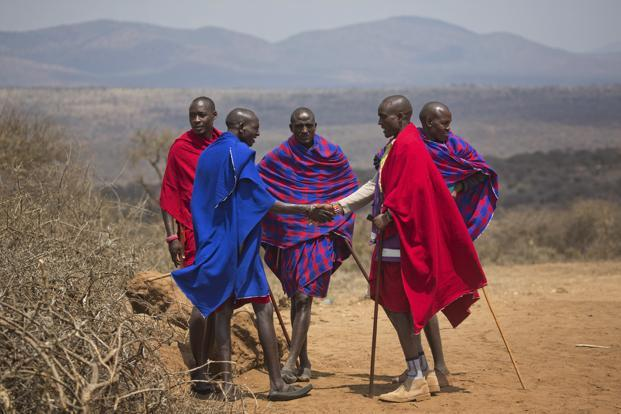 Maasai men greet each other outside a polling station in Eseki, Kenya, on Tuesday. Photo: Jerome Delay/AP