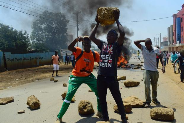 Angry protesters in the slums of Nairobi and the opposition stronghold of Kisumu burned tires, set up roadblocks and clashed with police, witnesses said. Photo: Kevin Midigo/AFP