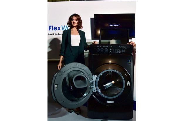 Samsung FlexWash comes with two drums—a 3.5kg top load and a 21kg drum at the bottom—to give consumers the flexibility to choose different wash cycles simultaneously. Photo: PTI