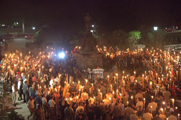White nationalists carry torches around a statue of Thomas Jefferson on the grounds of the University of Virginia, on the eve of a planned Unite The Right rally in Charlottesville, Virginia, on 11 August. Photo: Reuters/Alejandro Alvarez/News2Share