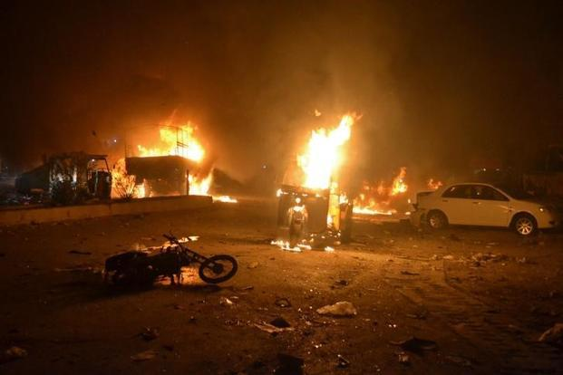 Vehicles are seen burning after a bomb blast in Quetta, Pakistan, on Saturday. Photo: Reuters