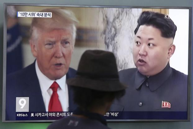 A man watches a television screen showing US President Donald Trump and North Korean leader Kim Jong Un during a news program at the Seoul Train Station in South Korea. Photo: AP
