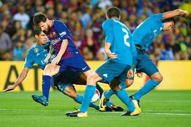 La liga another season of two team dominance livemint barcelonas lionel messi second from left against real madrid during the spanish supercup on stopboris Gallery
