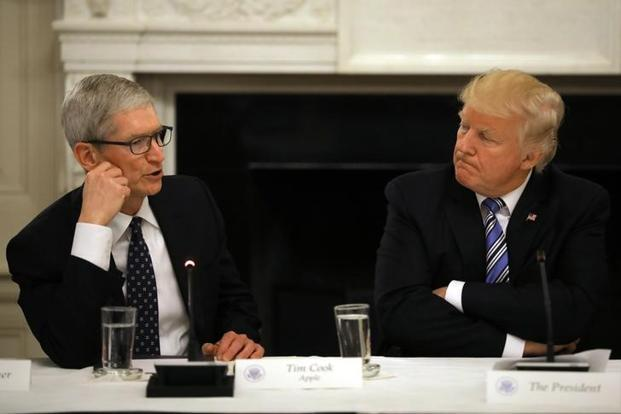Tim Cook said in a letter to Apple employees that the company will donate $1 million a piece to the Southern Poverty Law Centre and the Anti-Defamation League.  Photo: Reuters