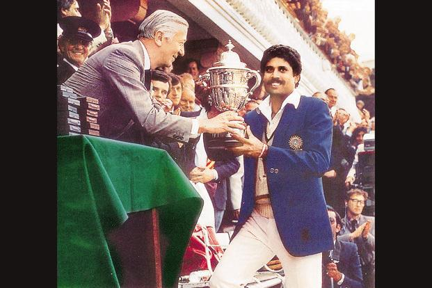 File photo of India captain Kapil Dev receiving the trophy after winning the 1983 Cricket World Cup.
