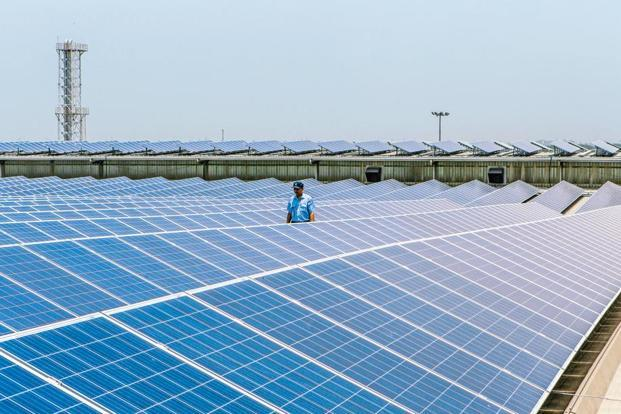 The guidelines for solar power purchase agreement, brought out by the ministry of new and renewable energy to standardise auctions, cover power projects of 5 megawatts and above. Photo: Bloomberg