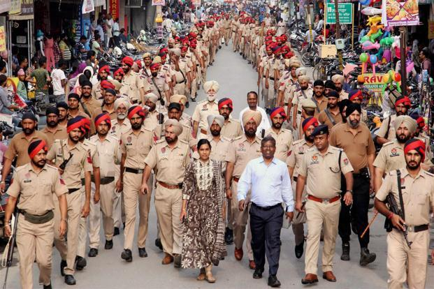 Administrative officials and police personnel at a flag march in Bathinda as Haryana and Punjab maintain high alert ahead of Friday's judgment. PTI