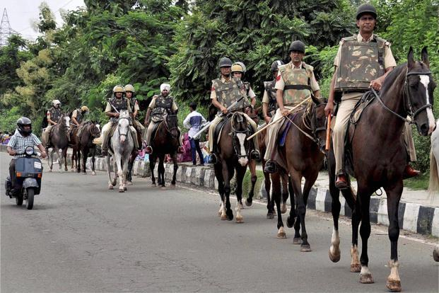 Police personnel at a march in Panchkula on Wednesday. PTI