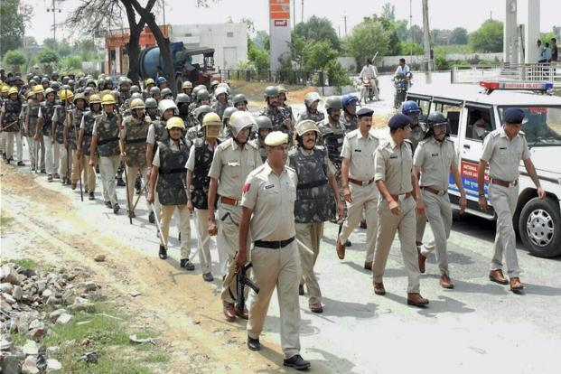 Police personnel at a march in Hisar on Wednesday. PTI