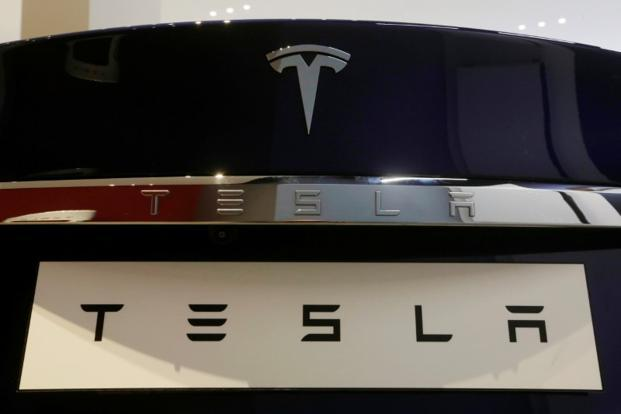 Tesla, Inc. (NASDAQ:TSLA) Trading Up - Insider Trading Activity