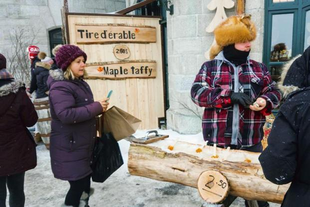 At taffy stands and sugar shacks, maple syrup is poured over ice and rolled around ice-cream sticks to make a delicious snack. Photo: iStockphoto