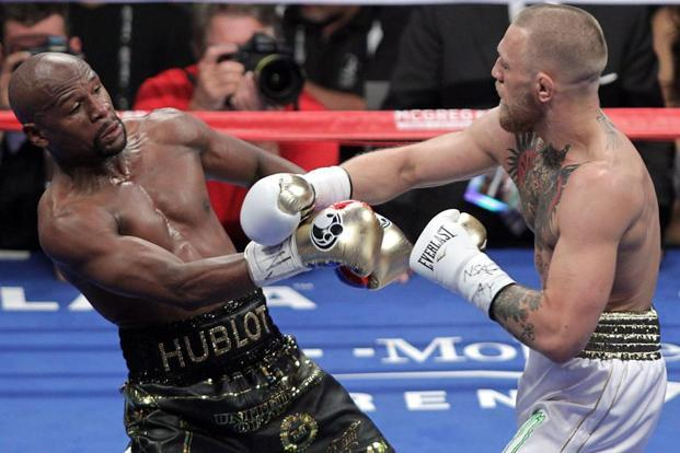 Floyd Mayweather (L) and Conor McGregor compete during their boxing match at the T-Mobile Arena in Las Vegas, Nevada, on Saturday. Photo: AFP