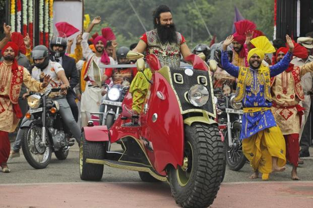 In this file photo Dera Sacha Sauda chief Gurmeet Ram Rahim Singh, arrives for a press conference ahead of the release of his film 'MSG, The Warrior Lion Heart,' in New Delhi. Photo: AP