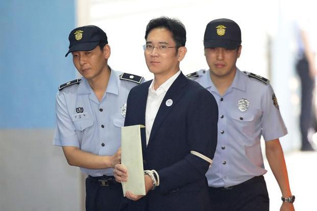 Jay Y. Lee (centre) has been convicted on bribery and embezzlement charges and sentenced to five years in prison. Photo: Bloomberg