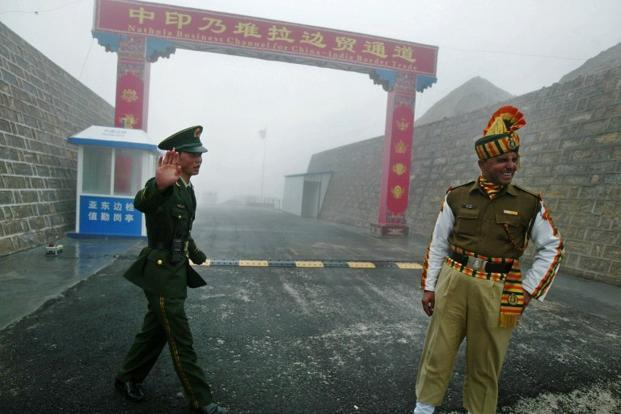 China says weather a factor in building roads along disputed India border