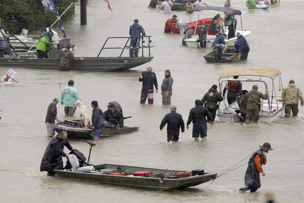 Texas levee breached; residents told to 'get out now!'