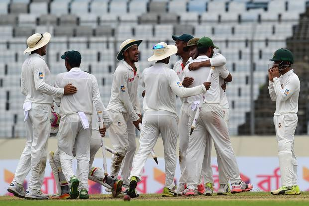 Bangladeshi cricketers celebrate after winning the first Test cricket match between Bangladesh and Australia at the Sher-e-Bangla National Cricket Stadium in Dhaka on Wednesday. Photo: AFP